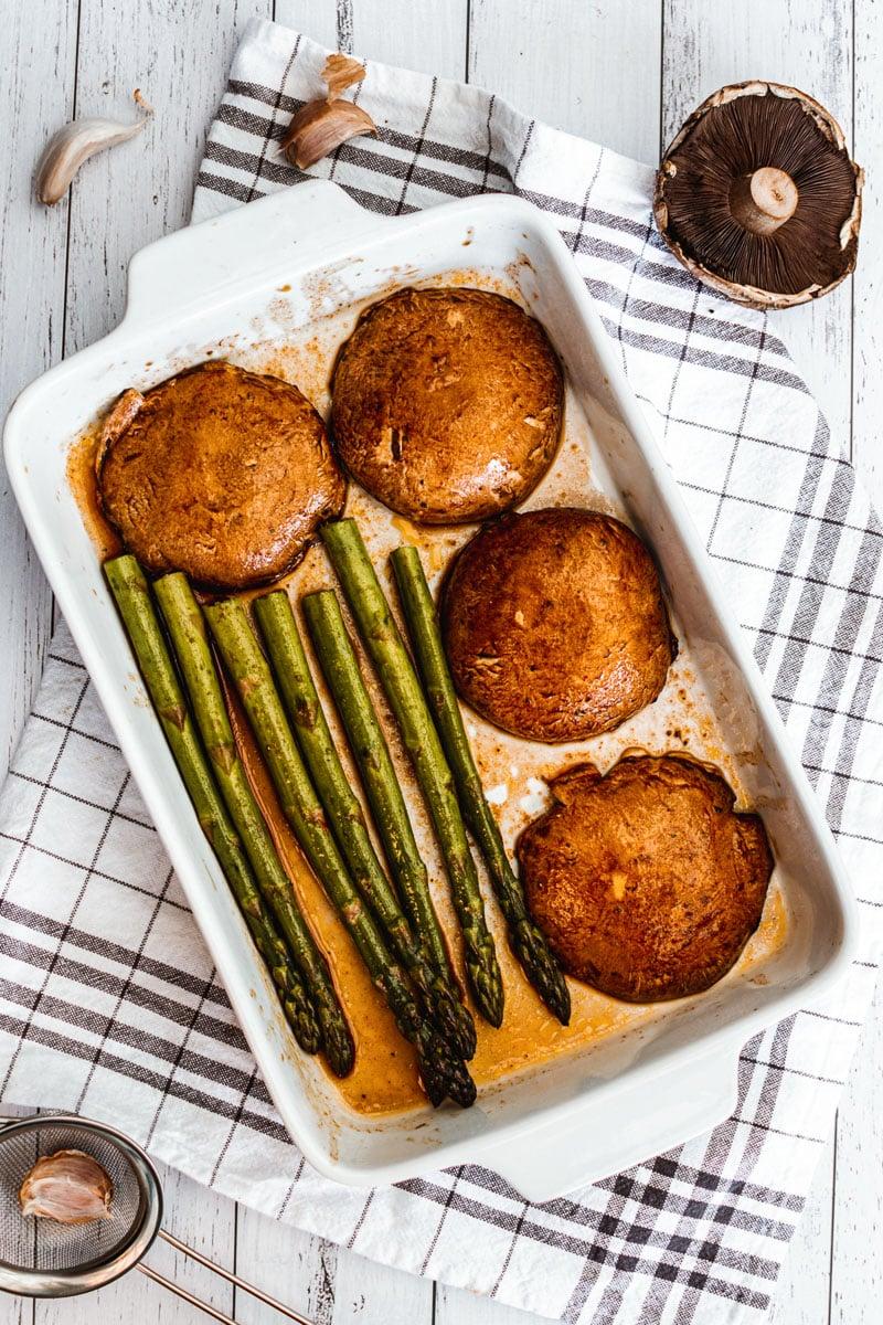pan with portobello mushroom steaks and asparagus