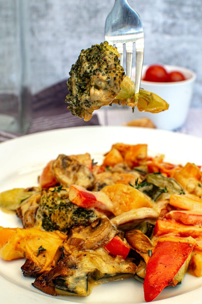 broccoli floret coated in vegan cheese sauce
