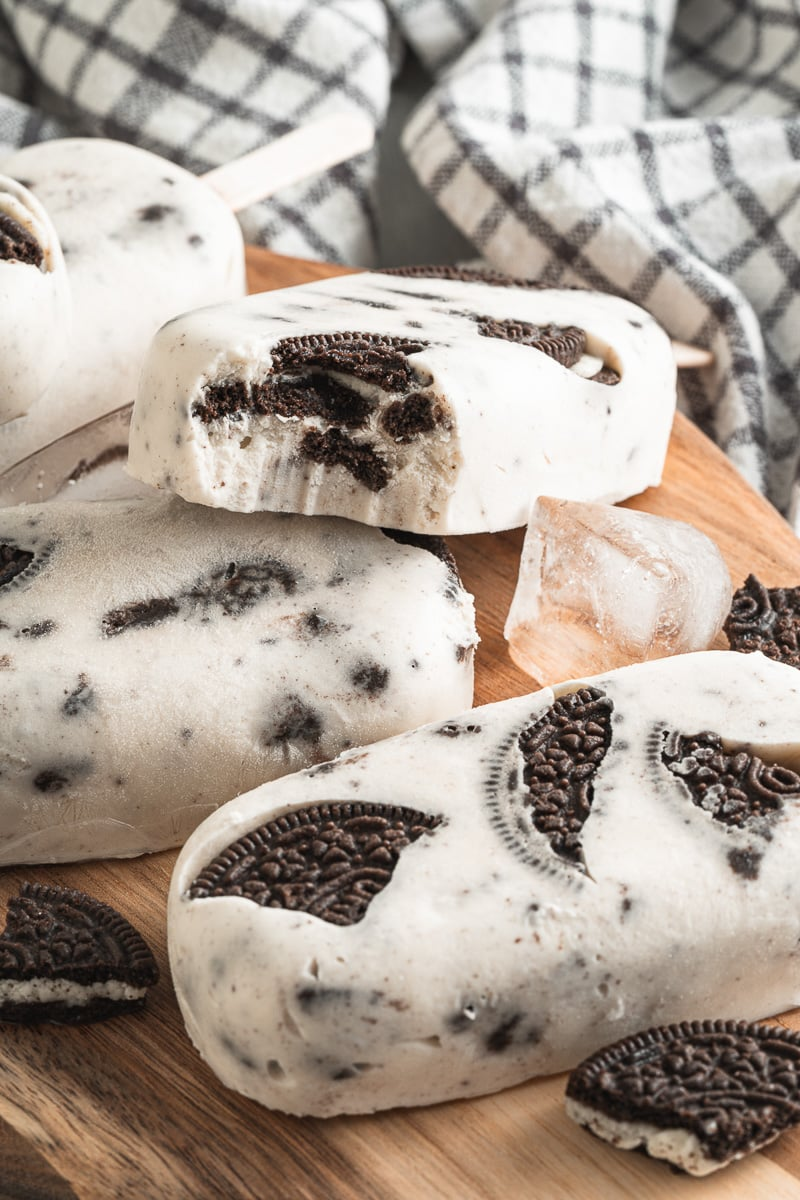 cookies & cream vegan popsicles with a bite taken out