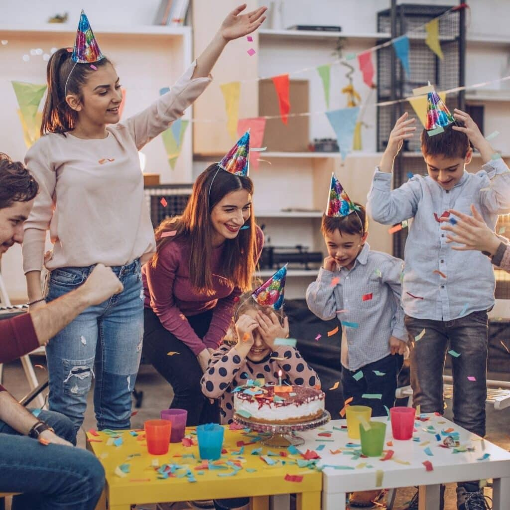 kids celebrating a birthday party in classroom