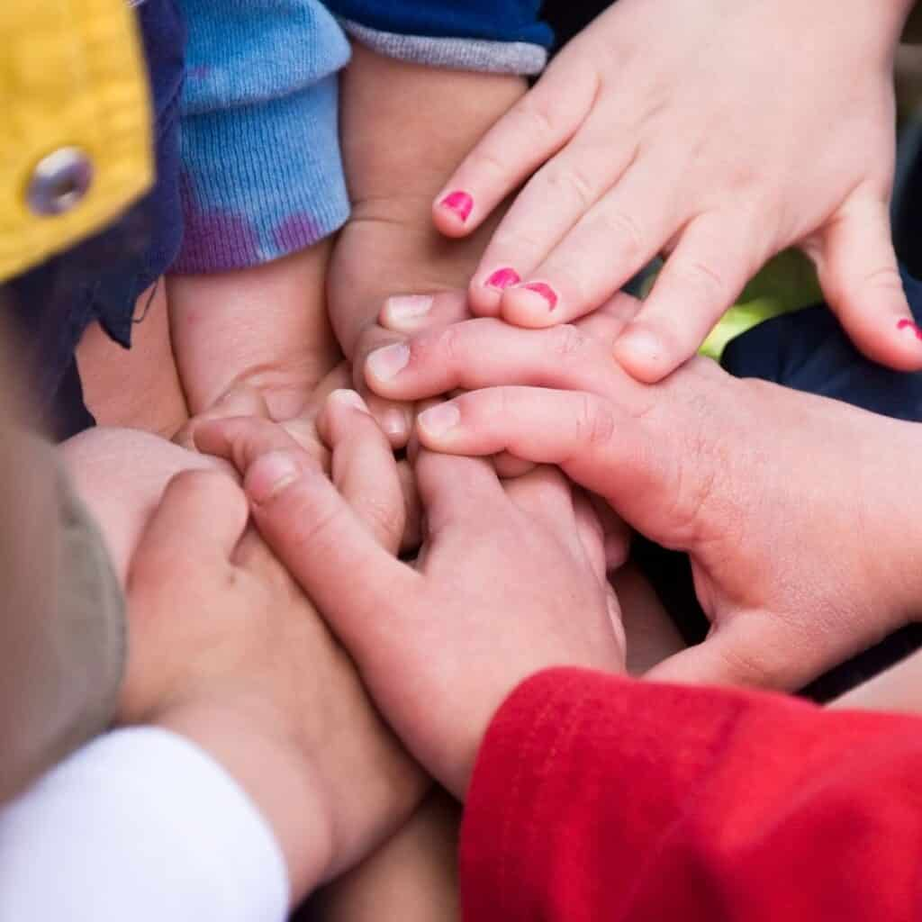 kids hands together as a team